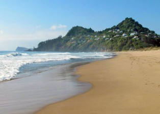 The golden sand beach in Tairua. House in New Zealand is privately sold