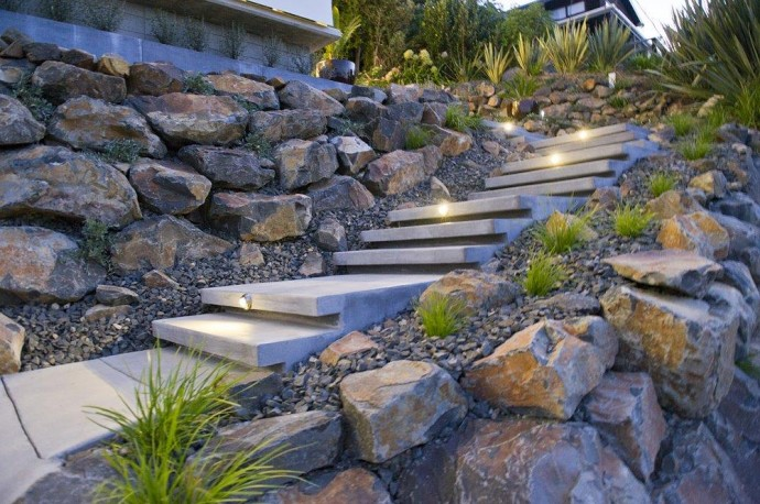 Home in New Zealand to sell. A stone staircase leads from street level to the terrace and living area.
