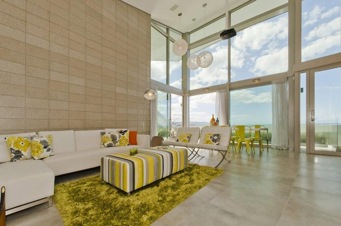 Great stylish living area with huge windows and ocean views. House in New Zealand