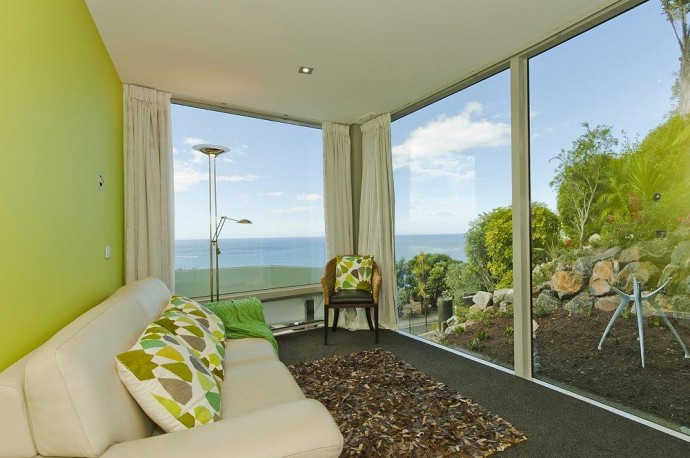 The New Zealand property offers a third bedroom for guests, or a recreation room with a view.